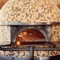 Imported Italian pizza oven crafted by famous oven-maker Stefano Ferrara heats to over 1000 degrees